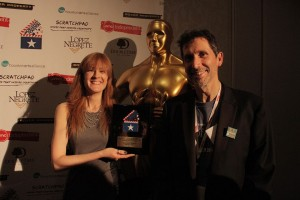 Christy and Dave receive their special WorldFest Remi Award